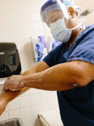 Healthcare Workforce Photography Technician scrubbing up before surgery