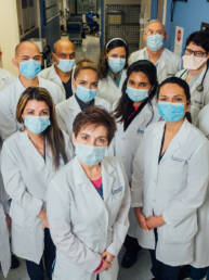 Pulmonary Doctors Group Photo Wearing Masks In Front of MICU