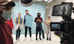 healthcare video production - Actors check wardrobe on set