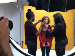 cosmetic healthcare video production - Wardrobe and Makeup artist do last minute touch ups